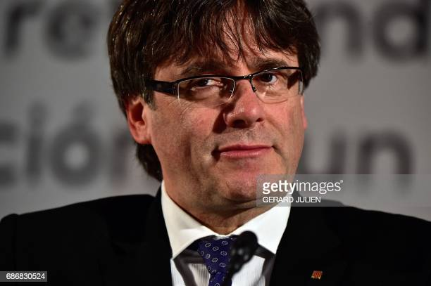 President of the Catalan government Carles Puigdemont looks on at the Madrid City Hall in the Cibeles palace before the conference 'A referendum for...
