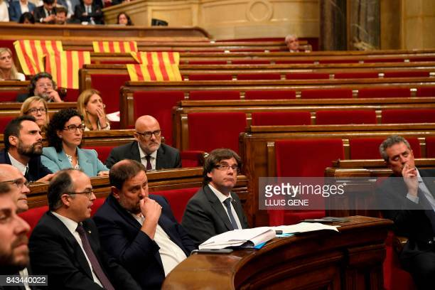 President of the Catalan Government Carles Puigdemont looks up after deputies of the Partido Popular displayed Spanish flags and leave the Catalan...