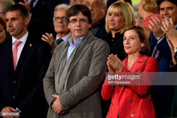 President of the Catalan Government Carles Puigdemont stands past president of the Catalan parliament Carme Forcadell as they wait for the Spanish...