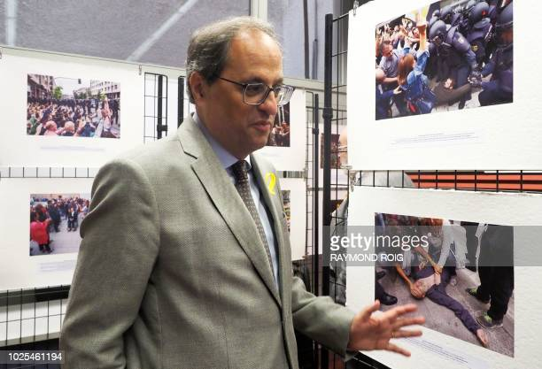President of The Catalan Government Quim Torra gestures as he visits a photographic exhibition on the events of Catalonia Visca per La Llibertat in...
