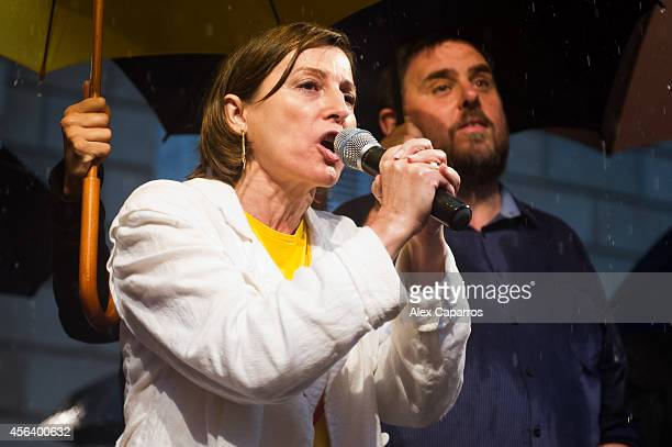 President of the Catalan National Assembly Carme Forcadell speaks to catalan Proindependence demonstrators protesting in front of the Barcelona City...