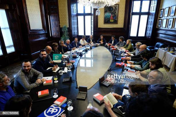 TOPSHOT President of the Catalan parliament Carme Forcadell attends a meeting with parliament representatives at the Catalan Parliament in Barcelona...
