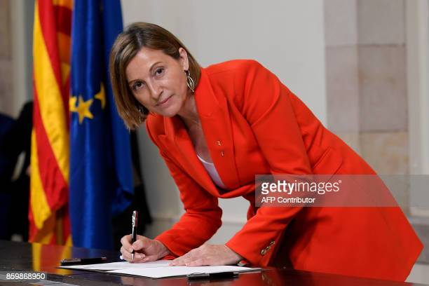 President of the Catalan parliament Carme Forcadell signs a document about the independence of Catalonia at the Catalan regional parliament in...