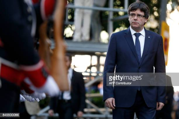President of the Catalan regional government Carles Puigdemont attends a ceremony at the Rafael de Casanovas monument in Barcelona on September 11...