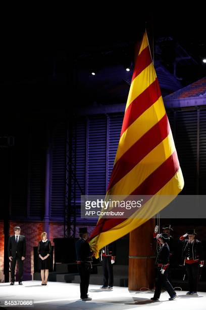 President of the Catalan regional government Carles Puigdemont and president of the Catalan parliament Carme Forcadell watch 'Mossos D'Esquadra'...