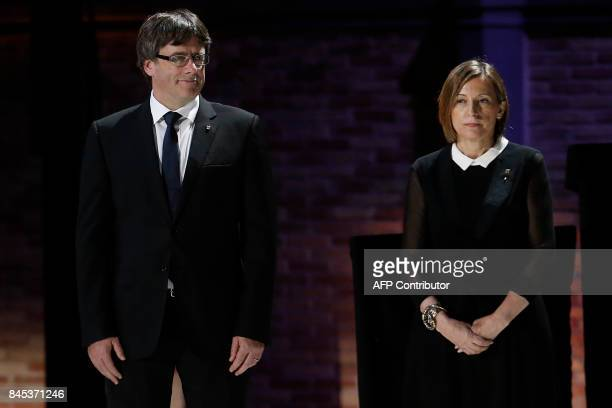 President of the Catalan regional government Carles Puigdemont and president of the Catalan parliament Carme Forcadell take part in an institutional...