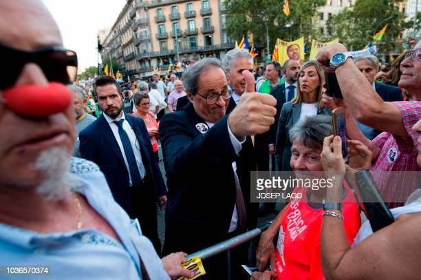 President of the Catalan regional government Quim Torra gives a thumbs up during a protest to demand freedom for the jailed Catalan leaders outside...