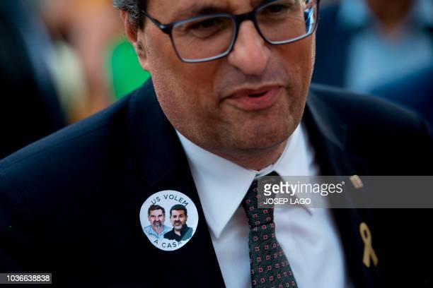 President of the Catalan regional government Quim Torra sports a sticker with portraits of jailed separatist leaders Jordi Sanchez and Jordi Cuixart...