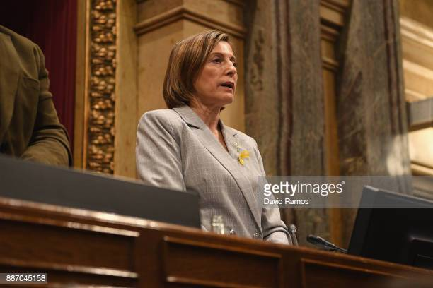 President of the Catalonia Parliament Carme Forcadell sings the national anthem after the Catalan Parliament voted in favour of independence from...