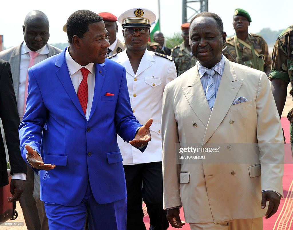 President of the Central African Republic Francois Bozize (R) greets the current president of the African Union and President of Benin Yayi Boni at the airport in Bangui, on December 30, 2012. Rebels in the Central African Republic who have advanced towards the capital Bangui warned they could enter the city even as the head of the African Union prepared to launch peace negotiations. Central African President Francois Bozize also stated today he was open to a national unity government after talks with rebel leaders and that he would not run for president in 2016.
