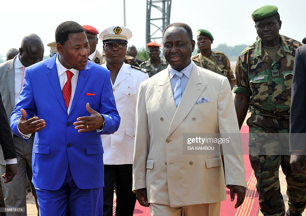 President of the Central African Republic Francois Bozize (C) greets the current president of the African Union and President of Benin Yayi Boni (L) at the airport in Bangui, on December 30, 2012. Rebels in the Central African Republic who have advanced towards the capital Bangui warned they could enter the city even as the head of the African Union prepared to launch peace negotiations. Central African President Francois Bozize also stated today he was open to a national unity government after talks with rebel leaders and that he would not run for president in 2016.
