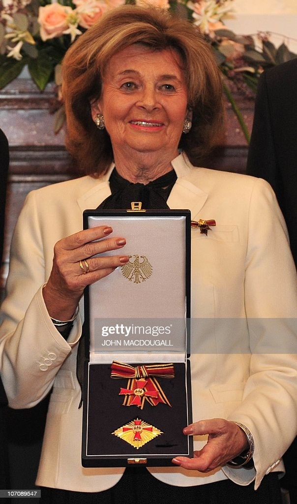 President of the Central Council of Jews in Germany Charlotte Knobloch displays her Order of Merit of the Federal Republic of Germany she received from German President Christian Wulff (not in picture) during a ceremony at the presidential palace in Berlin November 23, 2010.