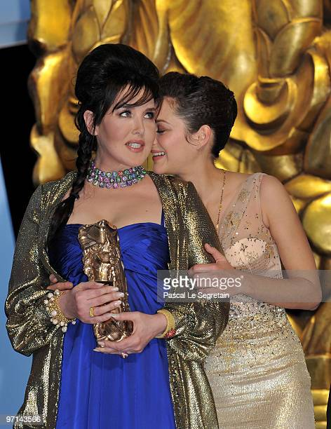 President of the ceremony actress Marion Cotillard congratulates Actress Isabelle Adjani for being awarded best Actress 2010 after the show at the...