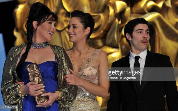 President of the ceremony actress Marion Cotillard congratulates Actress Isabelle Adjani for being awarded best Actress 2010 as Actor Tahar Rahim...