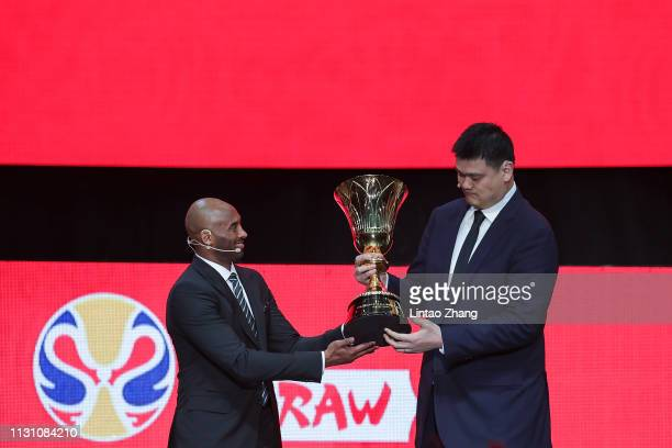 President of the Chinese Basketball Association Yao Ming receives the FBWC Trophy form Kobe Bryant during the FIBA Basketball World Cup 2019 Draw...