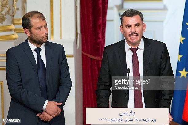 President of the civil committee of Aleppo Hagi Hasan Brita Syria's White Helmets leader Raed Saleh and French President Francois Hollande attend a...
