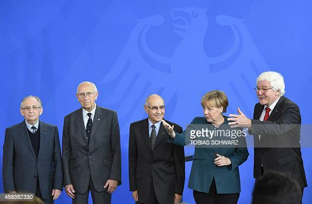 President of the Comite International de Dachau Pieter Dietz de Loos German Chancellor Angela Merkel pose for photographers after Merkel was awarded...
