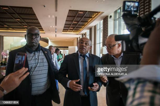 President of the Confederation of African Football Ahmad Ahmad gestures as he speaks to the Moroccan TV channel after an extraordinary meeting with...