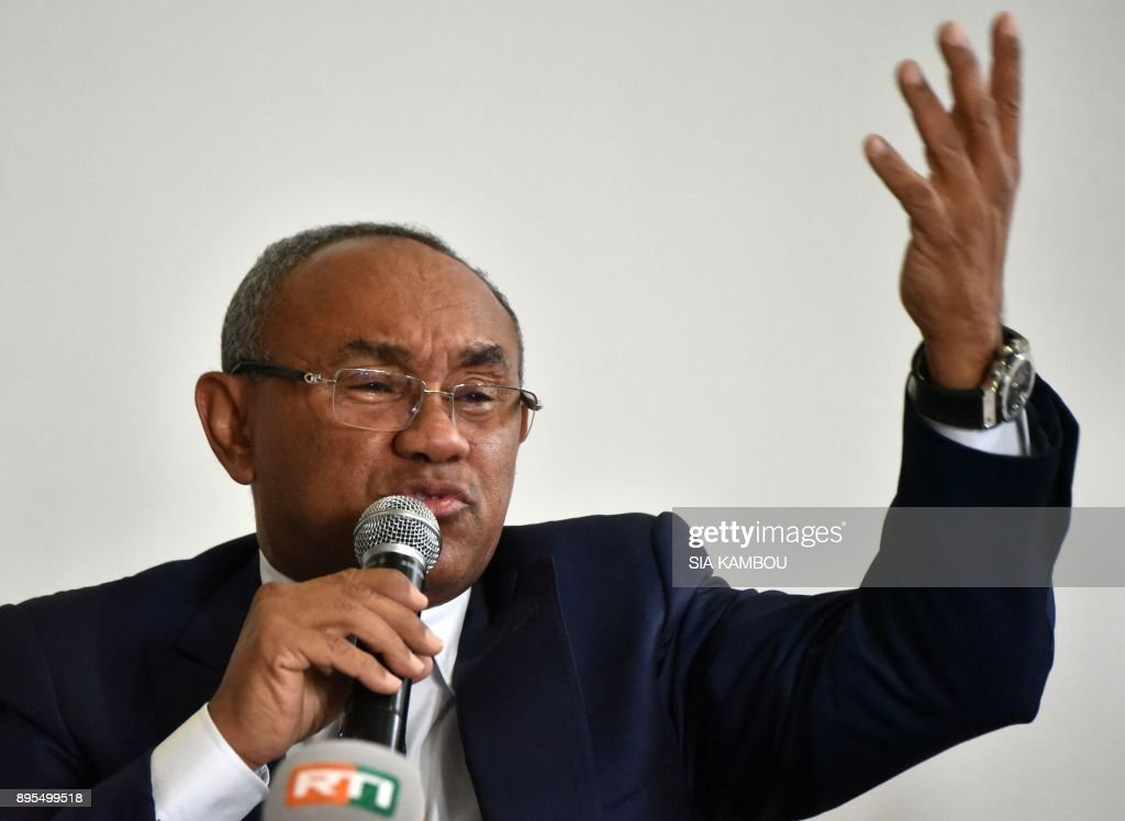 President of The Confederation of African Football (CAF) Ahmad Ahmad gestures as he addresses media representatives at a press conference in Abidjan on December 19, 2017
