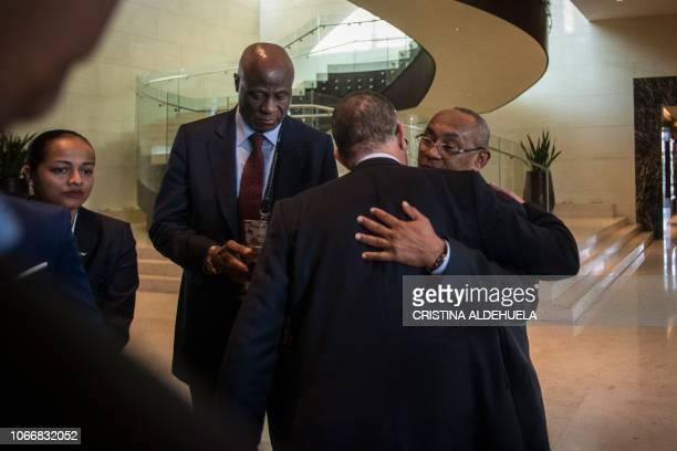 President of the Confederation of African Football Ahmad Ahmad salutes President of Moroccan Football Federation Fouzi Lekjaa after an extraordinary...