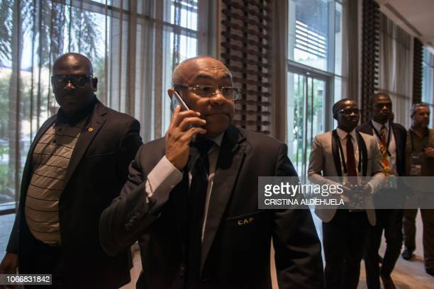 President of the Confederation of African Football Ahmad Ahmad speaks on the phone as he leaves after an extraordinary meeting with CAF executives at...