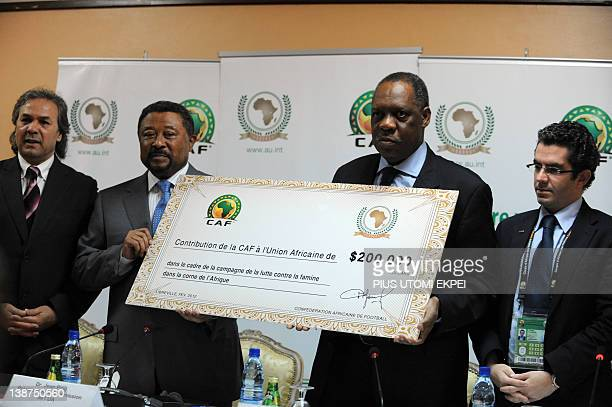 President of the Confederation of African Football Issa Hayatou presents a cheque of 200000 USD to the President of African Union Commission Jean...