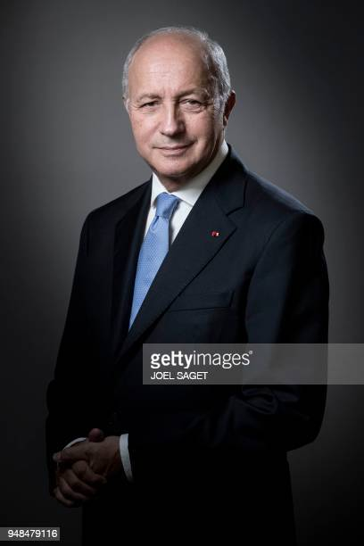 President of the Constitutional Council, Laurent Fabius, poses during a photo session in his office in Paris, on April 18, 2018. / AFP PHOTO / JOEL...