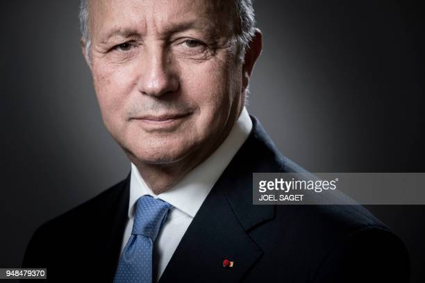 President of the Constitutional Council Laurent Fabius poses during a photo session in his office in Paris on April 18 2018 / AFP PHOTO / JOEL SAGET