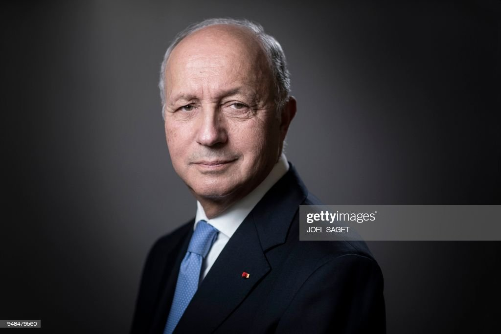 President of the Constitutional Council, Laurent Fabius, poses during a photo session in his office in Paris, on April 18, 2018. /