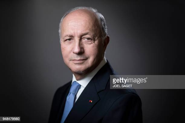 President of the Constitutional Council, Laurent Fabius, poses during a photo session in his office in Paris, on April 18, 2018.
