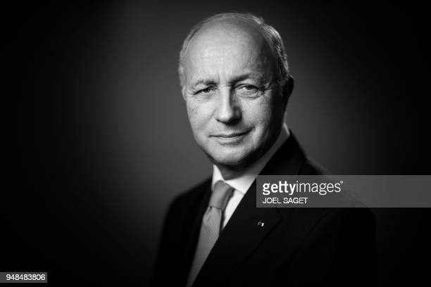President of the Constitutional Council Laurent Fabius poses during a photo session in his office in Paris on April 18 2018