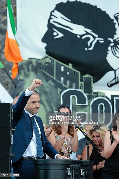 President of the Corsican assembly Jean Guy Talamoni holds up his fist at the end of a speech during the Ghjurnate Internaziunale di Corti on August...