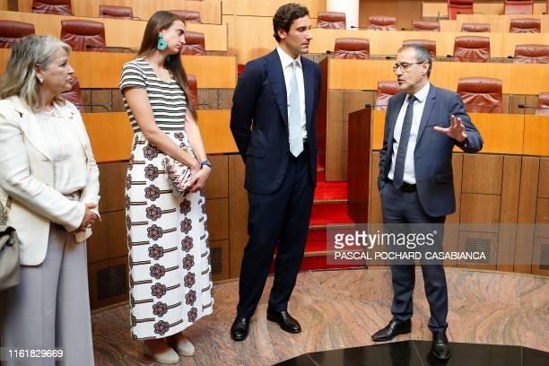 President of the Corsican Assembly Jean Guy Talamoni speaks to Napoleon Bonaparte's descendant Prince Jean Christophe Napoleon and his fiancee...