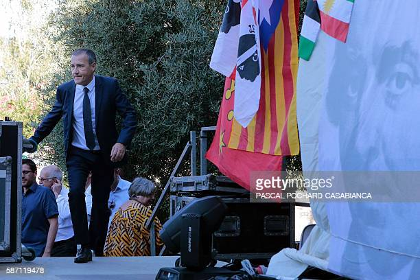 President of the Corsican assembly Jean Guy Talamoni steps on the stage before a speech during the Ghjurnate Internaziunale di Corti on August 7 2016...