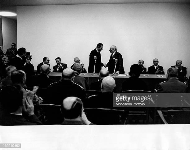 President of the Council of Ministers of the Italian Republic Aldo Moro congratulating publisher Arnoldo Mondadori during the opening of Mondadori...