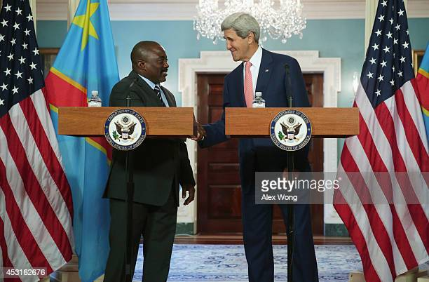 President of the Democratic Republic of Congo Joseph Kabila and US Secretary of State John Kerry shake hands before a bilateral meeting during the...