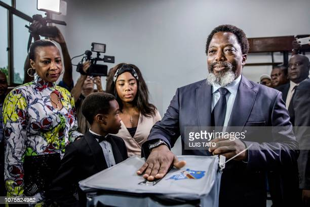 President of the Democratic Republic of Congo Joseph Kabila casts his vote along with his family at the Insititut de la Gombe polling station during...