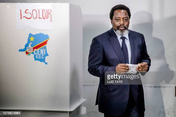 President of the Democratic Republic of Congo Joseph Kabila proceeds to cast his vote at the Insititut de la Gombe polling station during general...