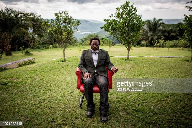TOPSHOT President of the Democratic Republic of the Congo Joseph Kabila sits in a garden at his personal ranch on December 10 2018 in Kinshasa