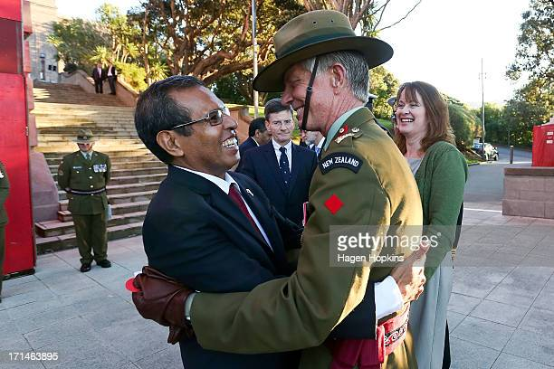 President of the Democratic Republic of TimorLeste Taur Matan Ruak embraces Martin Dransfield of the New Zealand Defence Force during a wreath laying...