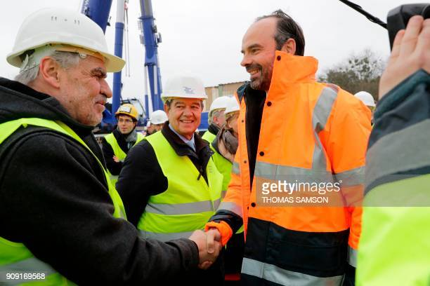 President of the Departmental Council of the ValdeMarne Christian Favier greets French Prime Minister Edouard Philippe as President of the Greater...