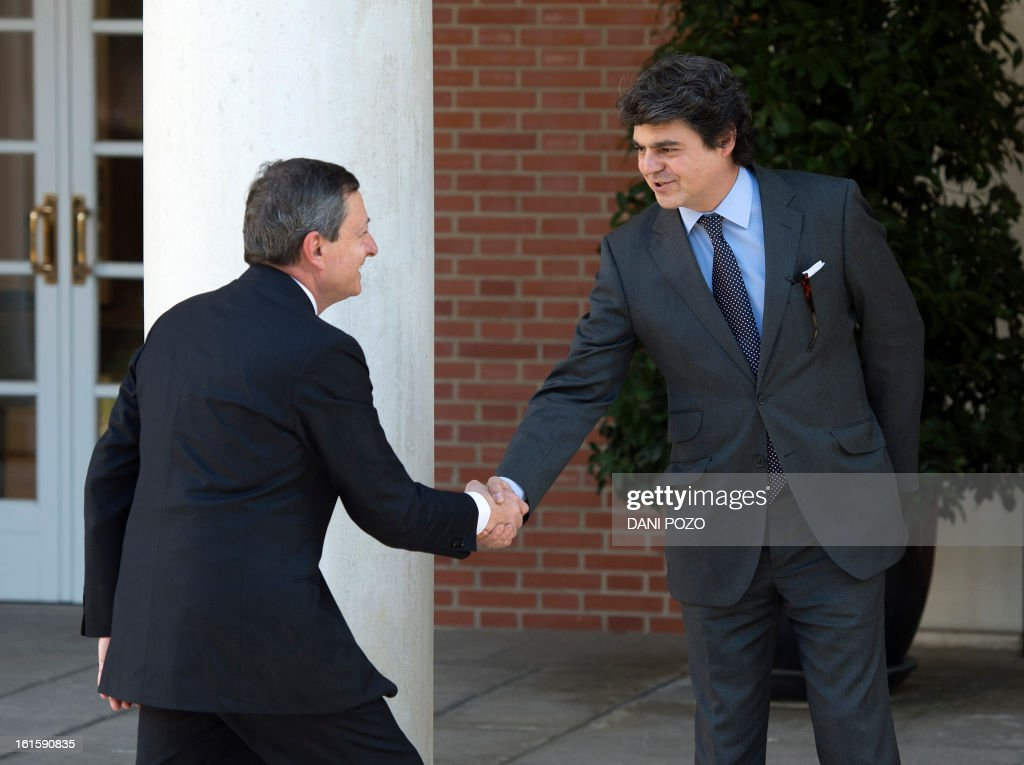President of the ECB (European Central Bank) Mario Draghi (L) shakes hands with Spanish Prime Minister's chief of staff Jorge Moragas (R) before their meeting at La Moncloa Palace in Madrid on February 12, 2013.