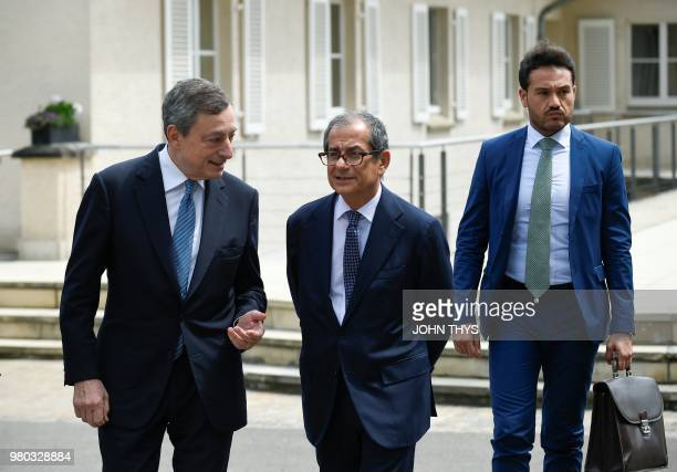 President of the ECB Mario Draghi talks with Italian Minister of Economy and Finance Giovanni Tria during a Eurogroup meeting at Senningen Castle in...