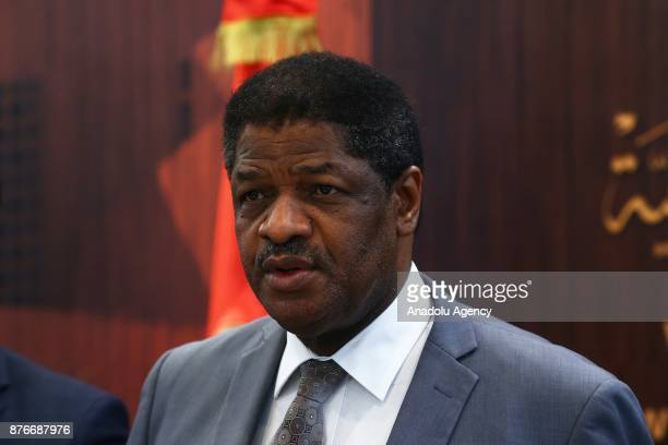 President of the Economic Community of West African States Marcel Alain de Souza and Foreign Affairs Minister of Tunisia Khemaies Jhinaoui hold a...