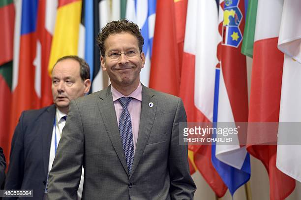 President of the Eurogroup Jeroen Dijsselbloem leaves at the end of an Eurozone Summit over the Greek debt crisis in Brussels on July 13 2015 Juncker...