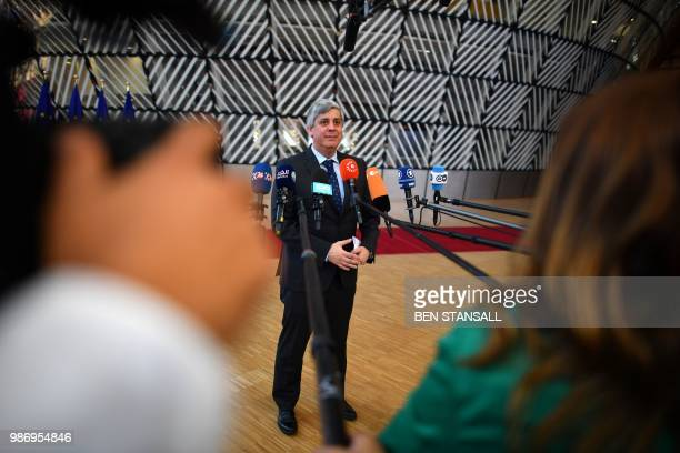 President of the Eurogroup Mario Centeno speaks to journalists as he arrives to take part in the last day of the European Union leaders' summit,...