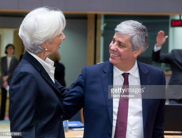 President of the European Central Bank Christine Lagarde is seen talking with the Portuguese Finance Minister, President of the group Mario Centeno...
