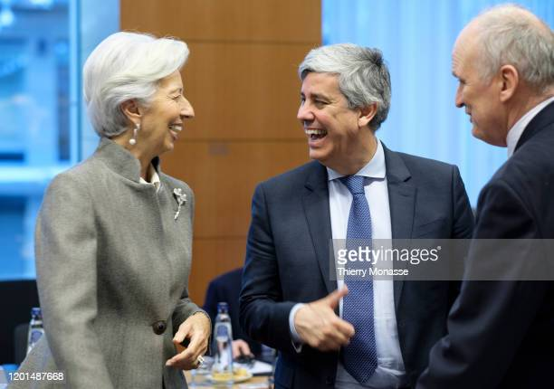 President of the European Central Bank Christine Lagarde is talking with the Portuguese Finance Minister, President of the group Mario Centeno and...