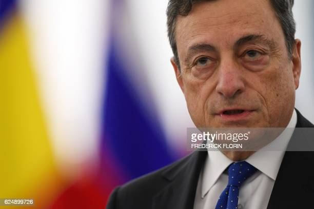 President of the European Central Bank Mario Draghi delivers a speech during a debate on the European Central Bank annual report for 2015 at the...