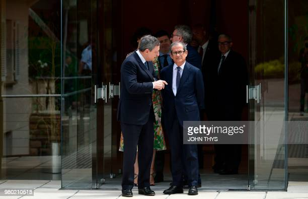 President of the European Central Bank Mario Draghi talks with Italian Minister of Economy and Finance Giovanni Tria during the 20th anniversary...